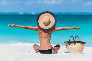 Summer vacation happy carefree joyful bikini woman arms outstret