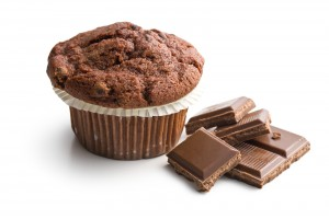 chocolate muffin with chocolate on white background