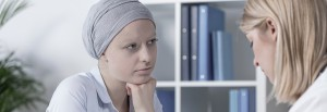 Cancer woman wearing scarf during medical consultation