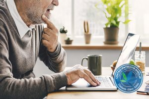 Senior Adult Using Laptop Thinking Concept