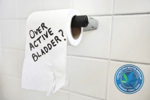 Close-up of toilet paper roll with text asking about bladder iss