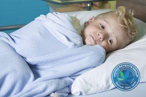 sick little boy in a hospital bed